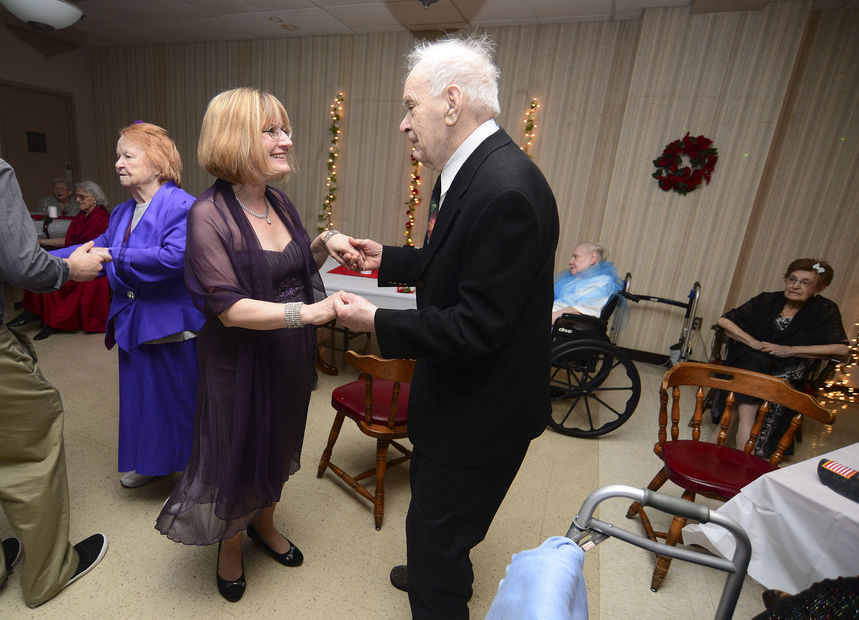 In honor of National Nursing Home Week, Rochester Manor and Villa held a prom for residents and their families on Thursday. Villa social director Debbie Graham dances with resident Mike Mazur.